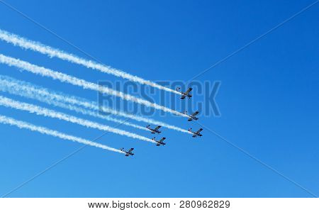 Doha, Qatar - Dec 14, 2018: Airshow. White Smoke Trail Of Six Planes On The Blue Sky. Parade