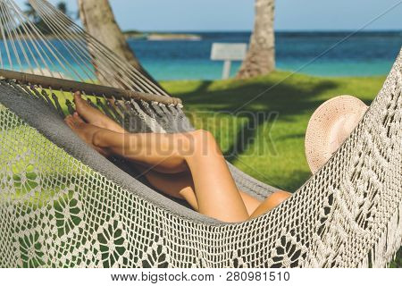 Beautiful Woman Relaxing In Hammock On The Beach. Healthy People Lifestyle. Woman Relaxing On The Be