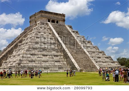 CHICHEN ITZA, MEXICO - AUGUST 11: crowded main pyramid on August 11, 2010 in Chichen Itza, Yucatan, Mexico
