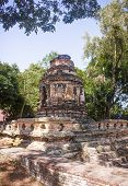 Ruins of Animisa Chedi, surrounded by trees. In Chiang Mai, Thailand. poster