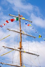 Masts of a sailing ship against the blue sky