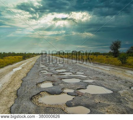 Road in Africa full with potholes, was not under maintenance or repairs for many years