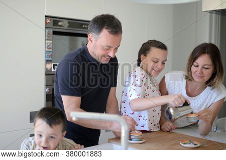 portrait of cheerful family in the kitchen