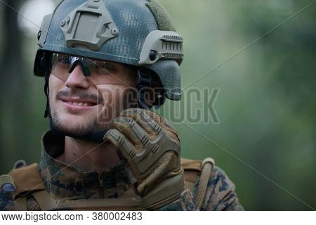 american  marine corps special operations soldier preparing tactical and commpunication gear for action battle closeup