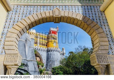 Sintra, Portugal - February 4, 2019: Exterior View Of The Pena Palace, Famous Colorful Castle From T