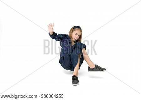 Beautiful Girl 10 Years Old Dancing Hip Hop On White Background In Studio. Isolated. Advertising Pho