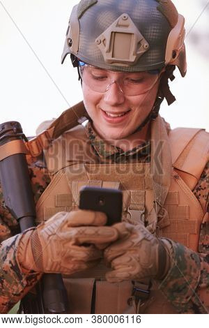 soldier using smart phone to contact family or girlfriend communication and nostalgia concept