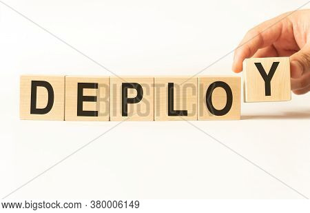Word Deploy Made With Wood Building Blocks, Stock Image