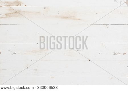 Top View On A White Wooden Background. Vintage Wooden Table Painted By White Paint.