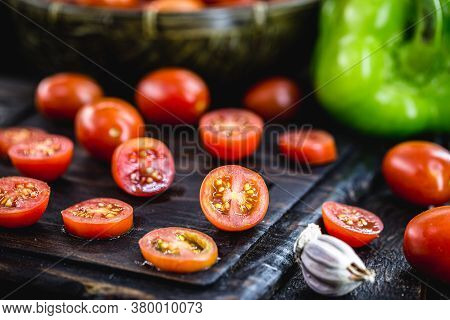 Small Red Tomato Used As A Culinary Ingredient In Rustic Cuisine, Sliced and Diced Tomatoes