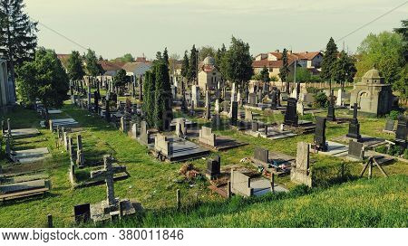 Sremska Mitrovica, Serbia, August 07, 2020. Cemetery In Serbia. Monuments And Hills. Summertime And