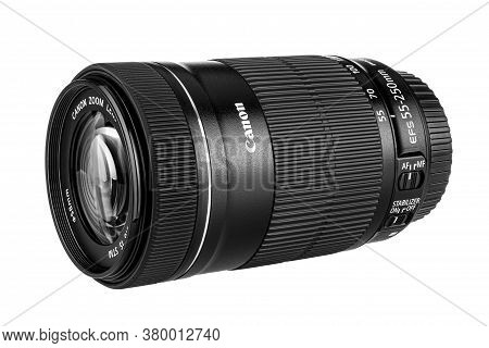 Moscow, Russia - July 18, 2020: Lying Canon Ef-s 55-250 Mm Lens With Open Front Protective Cap Isola