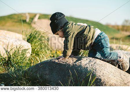 Close Up On Girl Climbing On Rock