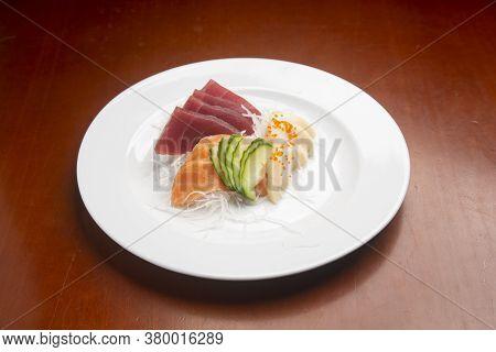 Japanese Typical Food Sashimi Moriwase On Wooden Background