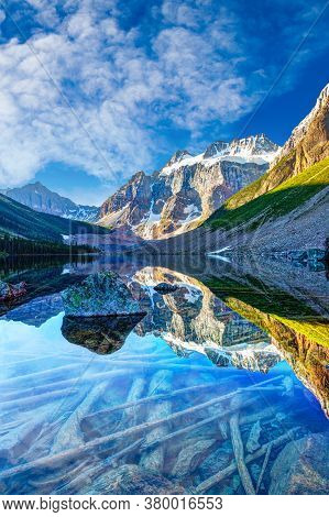 Beautiful Glacier-covered Mount Quadra Reflecting Off Consolation Lake On Moraine Lake Hike Near Lak