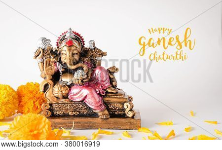Happy Ganesh Chaturthi Festival, Bronze Ganesha Statue And Golden Texture With Flowers, Ganesh Is Hi