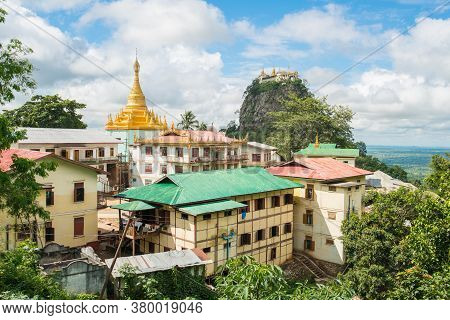 Buddhist Monastery With Mount Popa An Ancient Volcano And Home Of