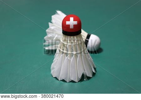 Used Shuttlecock And On Head Painted With Switzerland Flag Put Vertical And Out Focus Shuttlecock Pu