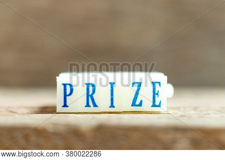 Letter Block With Blue Color Word Prize On Wood Background