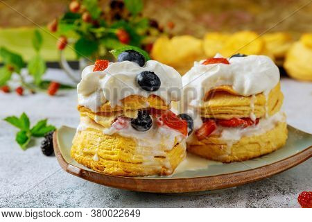 Layered Flaky Biscuit With Berry And Whipped Cream. Close Up.