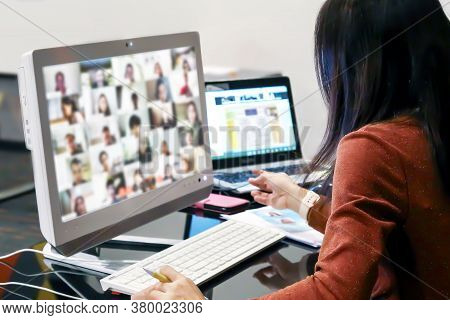 Office Women Using Computer Laptop For Online Meetings Or Online Elearning Or Teaching Students With