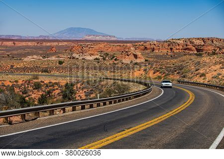 Asphalt Road In Usa. Barren Scenery. Desert Highway Of The American Southwest. Endless Straight. Rou