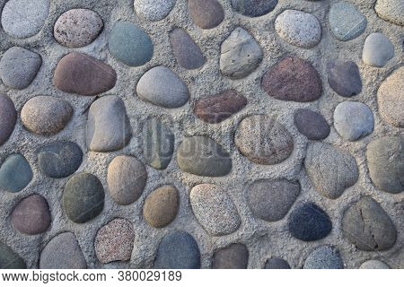 Stone Background. Walls Of Neatly Arranged Stones. Stone Surface. Detail Of Floor Tiles Useful As A