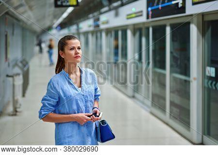 Sad Woman With Handbag In Subway Station