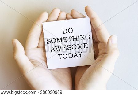 White Paper With Text Do Something Awesome Today In Male Hands On A White Background