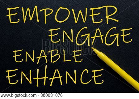 Empower Engage Enable Enhance Yellow Pen With Yellow Text Own Rent At The Black Background