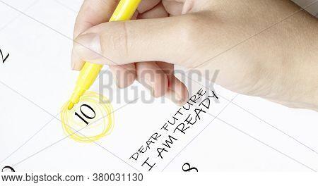 Hand Encircles A Date On A Calendar With Text Dear Future I Am Ready Yellow Felt-tip Pen