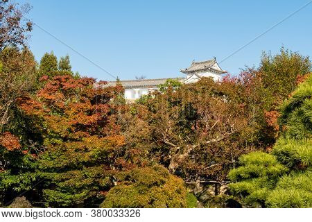 View Of Himeji Castle Buildings From Koko-en Japanese Garden Through Colorful Autumn Leaves, Himeji,