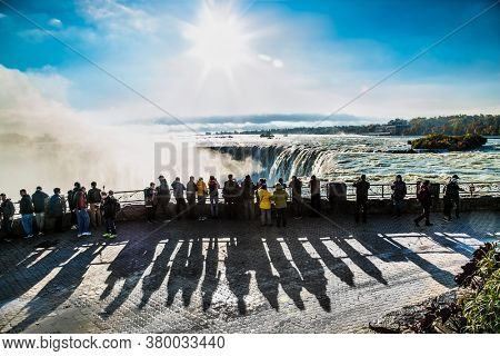 Niagara falls, Canada-Oct 28, 2019: People over Niagara Falls on a beautiful sunny day. Canada site, Canadian view. Niagara Falls are three waterfalls at the southern end of Niagara Gorge