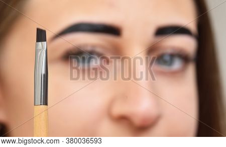 Henna Eyebrow Brush And Female Face. Beauty And Care Concept