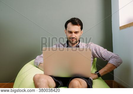 Happy Man Working From Home Using Laptop