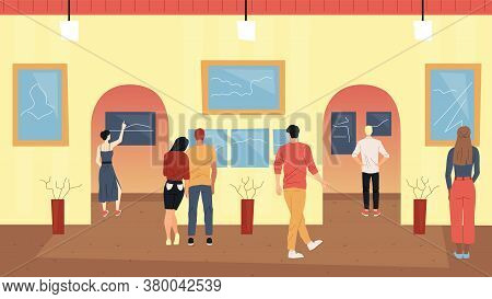 Art Concept. Young People Walk Around The Hall Of The Art Exhibition And Look At Paintings In Frames