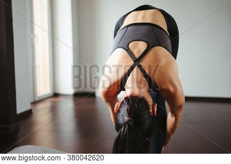Flexibility, Fitness, Perfect Body. Young Fit Woman Doing Stretching Exercise At Home Training. Self