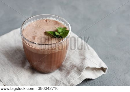 Chocolate Drink, Smoothie In A Glass Glass With A Sprig Of Mint On A Linen Napkin. Dessert Drinks. G
