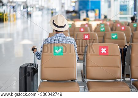 Young Male Wear Face Mask Sitting On Chair In Airport Terminal, Protection Coronavirus Disease (covi