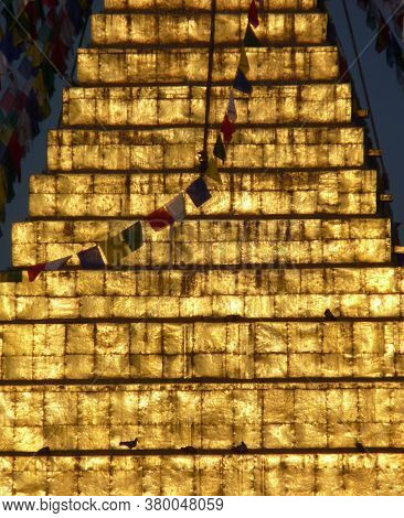 Close Up Of Golden Boudhanath Stupa With Cascading Prayer Flags, In Tibetan Enclave Of Kathmandu, Ne