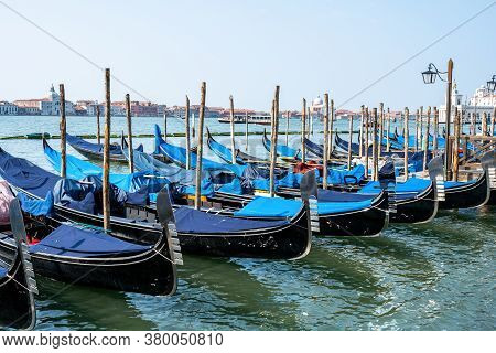 Gondolas At The Piazza San Marco In Venice, Italy