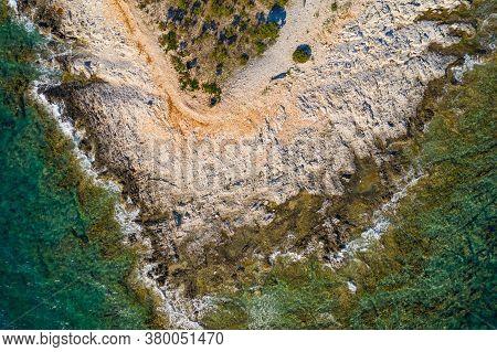 Adriatic Coastline In Croatia, Dugi Otok Island. Rocky Cape And Sea Surface, Drone Overhead View.
