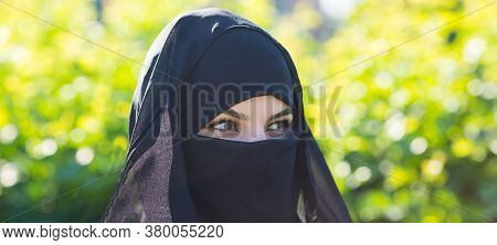A Migrant Woman From The East In Black Clothes. A Migrant Woman From The East In Black Clothes Is St