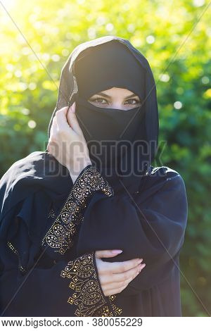 A Migrant Woman From The East In Black Clothes. A Migrant Woman From The East Black Clothes Is Stand