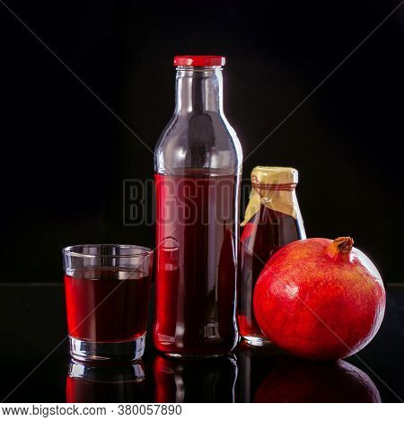 Fresh Pomegranate Juice In A Bottles And Glass.