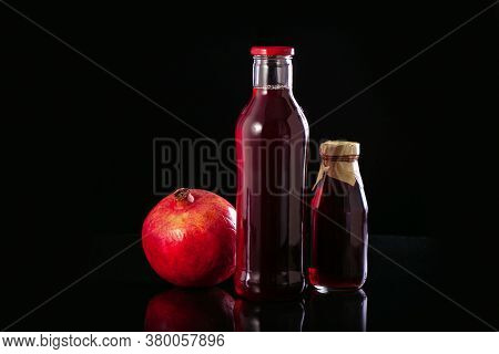 Fresh Pomegranate Juice In A Bottles. Healthy Drink Concept.