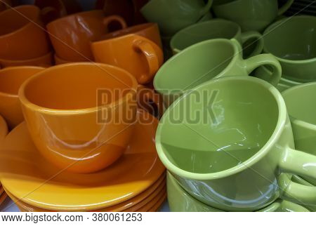 Ceramic Cup With Saucer, Cups Of Ceramics Of Different Colors In The Store