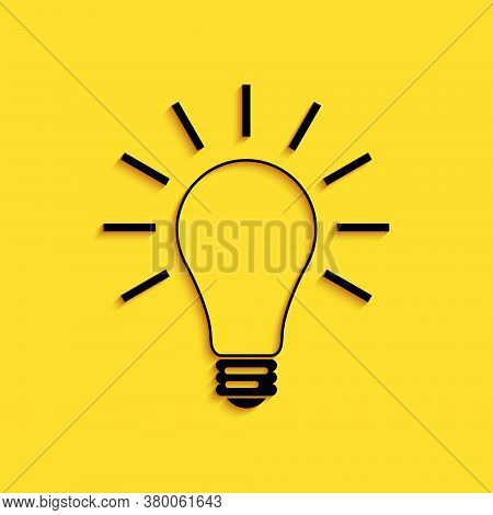 Black Light Bulb With Rays Shine Icon Isolated On Yellow Background. Energy And Idea Symbol. Lamp El