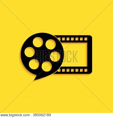 Black Film Reel And Play Video Movie Film Icon Isolated On Yellow Background. Long Shadow Style. Vec