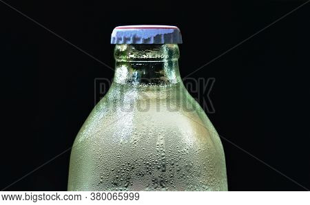 Soda Carbonate Water With Bubble Floating In Glass Bottle On Black Background